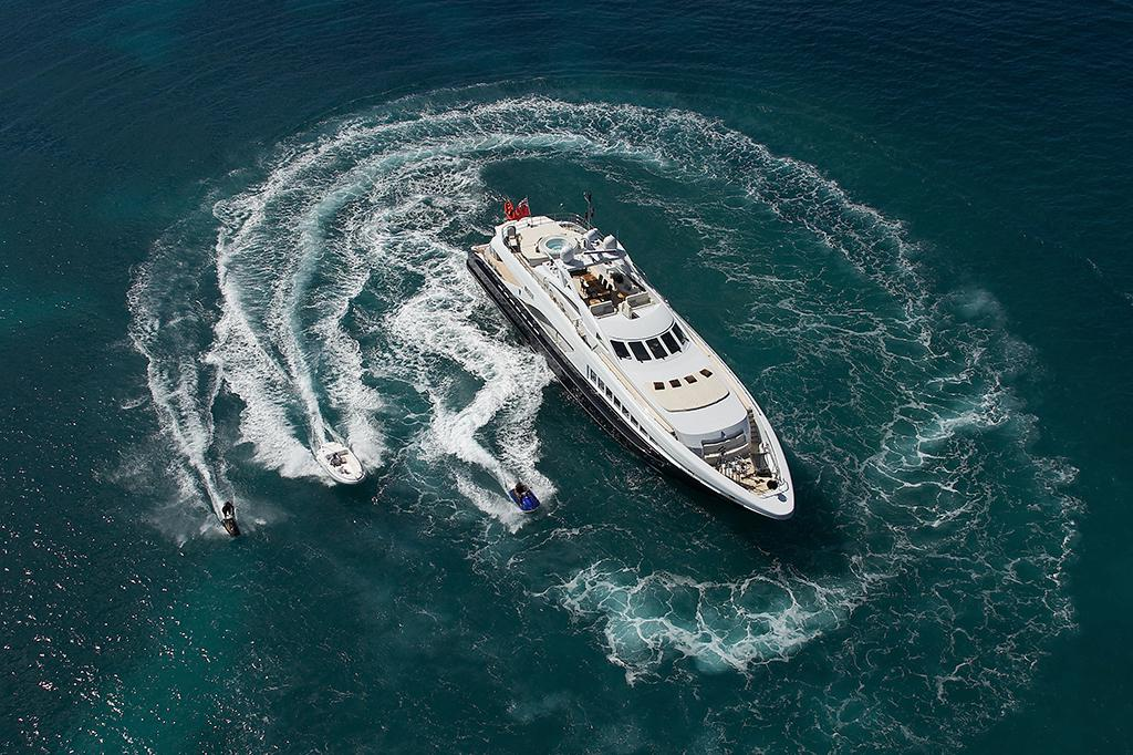 Yachts for charter in the caribbean and the mediterranean that were booked by yacht broker merle wood & associates with charter guests playing on water toys